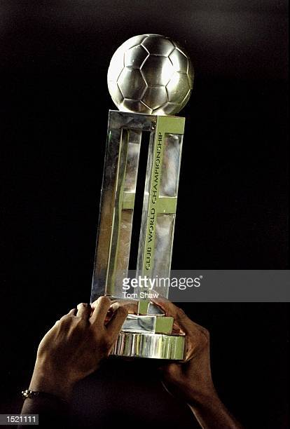 The FIFA World Club Championship trophy is held aloft by Freddy Rincon captain of Corinthians following victory over Vasco de Gama at the Maracana...