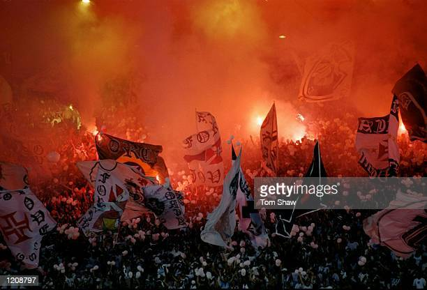 The Vasco de Gama fans wave flags and light flares during the Final of the World Club Championship against Corinthians played at the Maracana Stadium...
