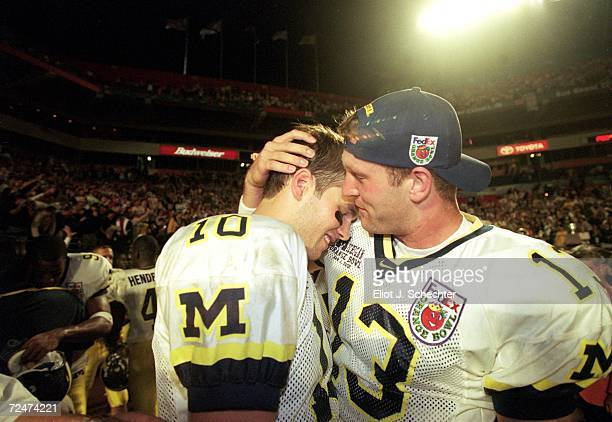 Tom Bradly and Jason Kapner of the Michigan Wolverines celebrate after winning the Orange Bowl Game against the Alabama Crimson Tide at the Pro...