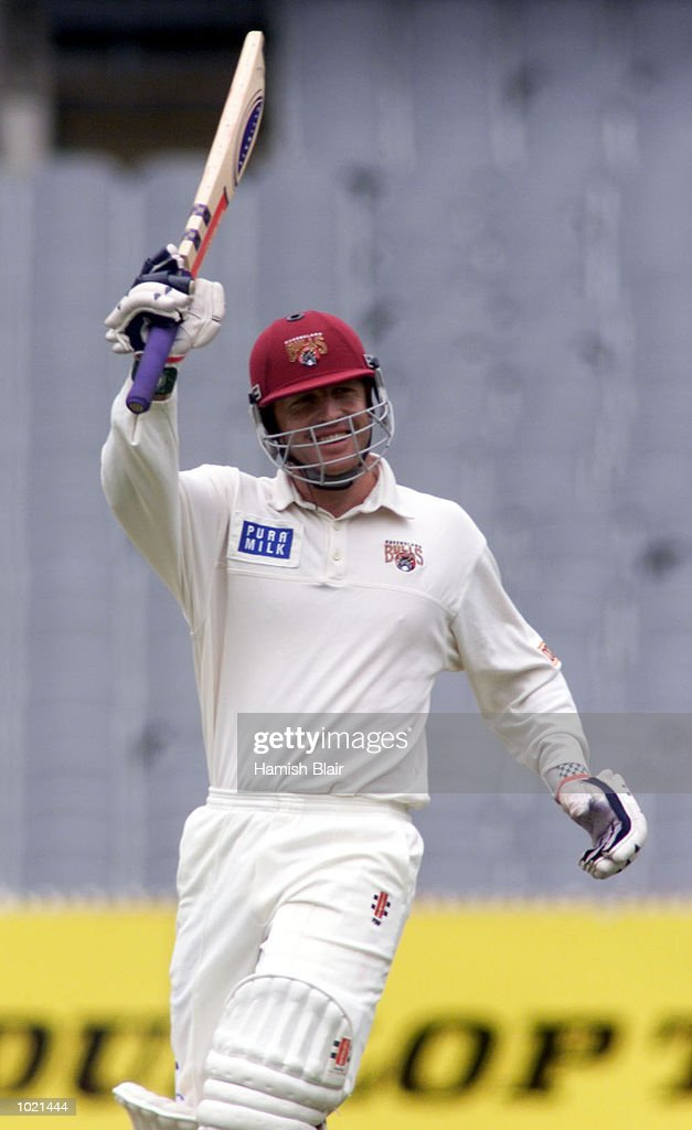 Wade Seccombe of Queensland celebrates his century, during the Pura Milk Cup match between Victoria and Queensland at the Melbourne Cricket Ground, Melbourne, Australia Mandatory Credit: Hamish Blair/ALLSPORT