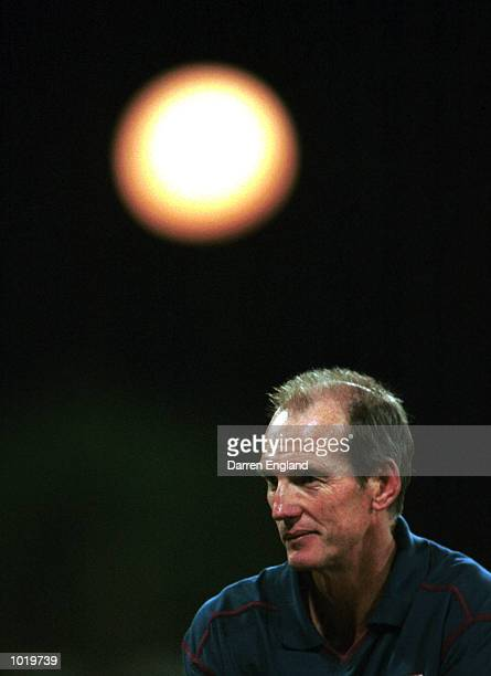 Wayne Bennett of the Brisbane Broncos watches the game under a full moon during the N.R.L. Trial game against the North Queensland Cowboys played at...