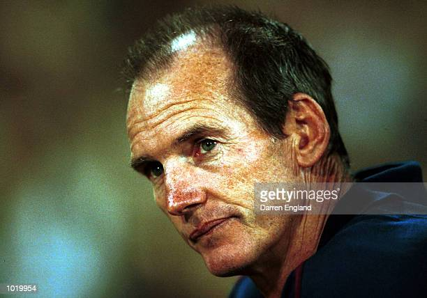 Wayne Bennett of the Brisbane Broncos watches the state of play during the NRL trial game against the North Queensland Cowboys played at Cararra...