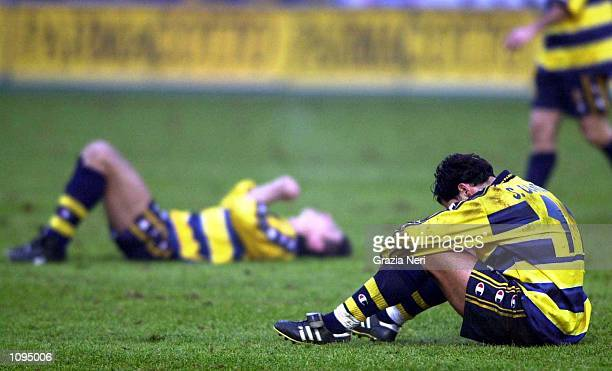 A downcast Sergio Conceicao of Parma sits on the ground after a Serie A 15th Round League match between Parma and Lecce played at the Ennio Tardini...