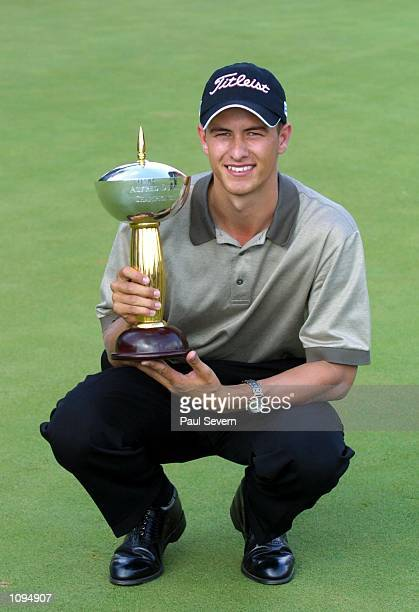 Adam Scott of Australia with the trophy after winning the Alfred Dunhill Championship at Houghton GC in Johannesburg South Africa Mandatory Credit...