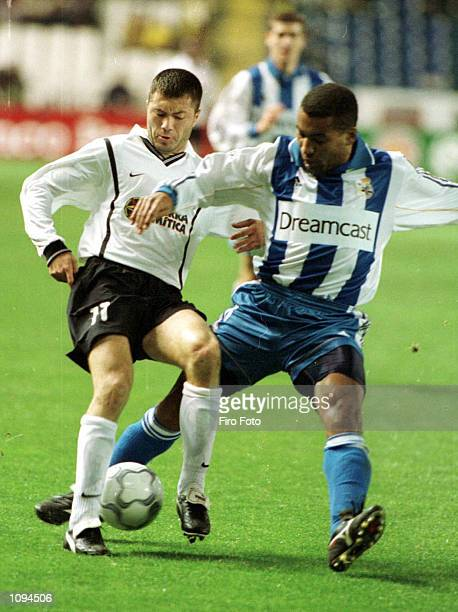 Adrian Ilie of Valencia tangles with Mauro Sliva of Deportivo during the Deportivo La Coruna v Valencia La Liga match played at Municipal de Riazor...