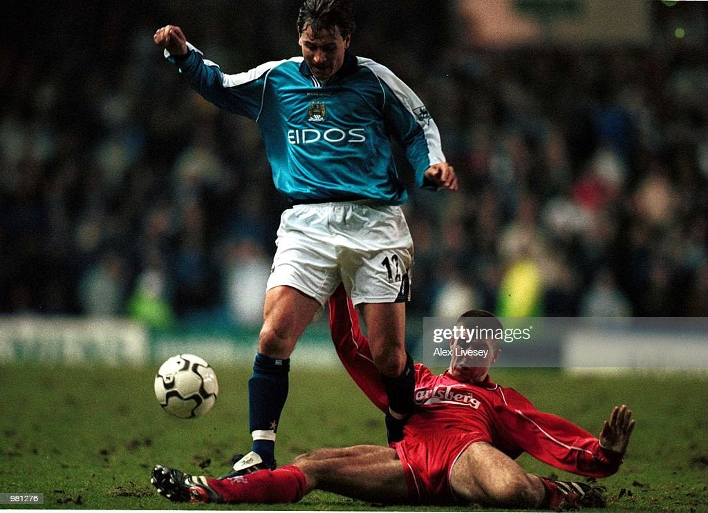 https://media.gettyimages.com/photos/jan-2001-andrei-kanchelskis-of-man-city-skips-the-challenge-of-steve-picture-id981276