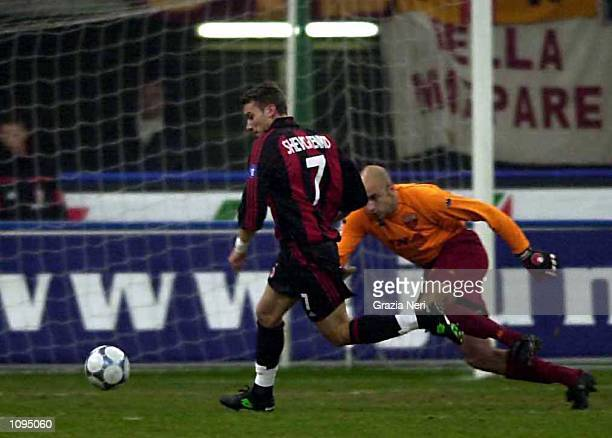 Andriy Shevchenko of AC Milan goes round the goalkeeper to score a goal during the Serie A 15th Round League match between AC Milan and Roma played...