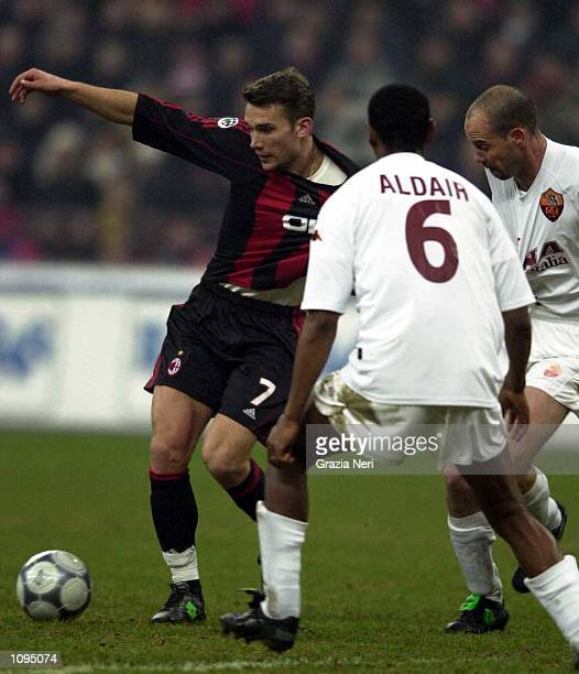 Andriy Shevchenko of AC Milan is tackled by Aldair and Zago of Roma during the Serie A 15th Round League match between AC Milan and Roma played at...