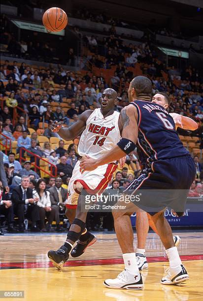 Anthony Mason of the Miami Heat moves in to get the ball against Kenyon Martin of the New Jersey Nets during the game at the American Airlines Arena...