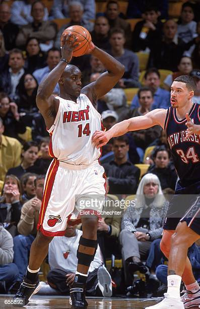 Anthony Mason of the Miami Heat tries to pass the ball against Aaron Williams of the New Jersey Nets during the game at the American Airlines Arena...