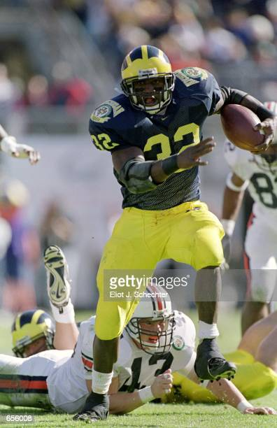 Anthony Thomas of the Michigan Wolverines runs with the ball during the Citrus Bowl Game against the Auburn Tigers at the Citrus Bowl in Orlando...