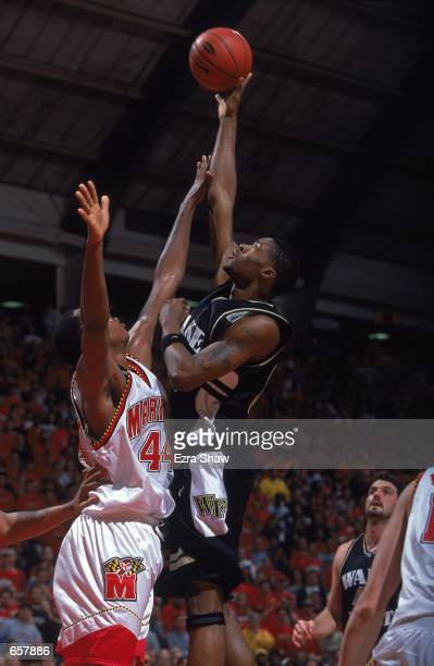 Antwan Scott of the Wake Forrest Demon Deacons shoots against Terence Morris of the Maryland Terrapins during the game at the College Field House in...