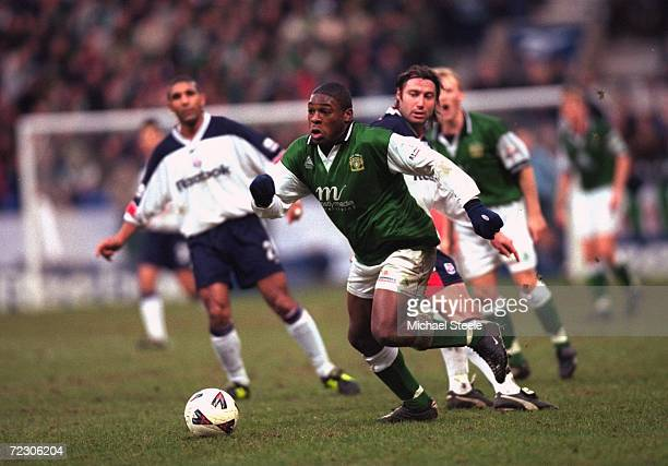 Barrington Belgrave of Yeovil Town runs through the Bolton Wanderers defence during the AXA sponsored FA Cup 3rd round match played at the Reebok...