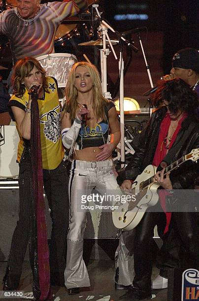 Britney Spears performs with Aerosmith during the halftime show of Super Bowl XXXV at Raymond James Stadium in Tampa Florida DIGITAL IMAGE Mandatory...