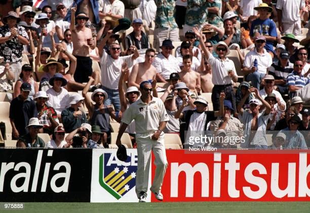 Colin Miller with his new blue hair cut is applauded by the crowd during the third days play of the Fifth Test Match between Australia and West...