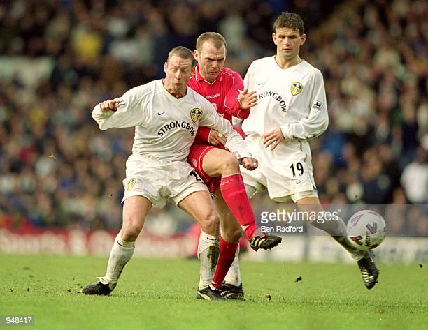 Danny Murphy of Liverpool is squeezed out by David Batty and Eirik Bakke of Leeds United during the FA Cup Fourth Round match at Elland Road in...