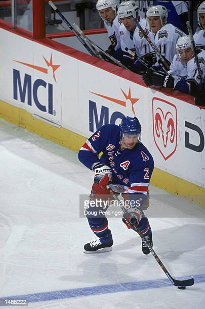 Defenseman Brian Leetch of the New York Rangers skates with the puck during the NHL game against the Washingon Capitals at the MCI Center in...