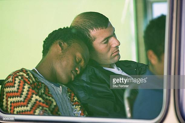 Football's biggest fan Sonny falls asleep on the shoulder of Zinedine Zidane of Juventus and France during the Adidas I Kiss Football Commercial...