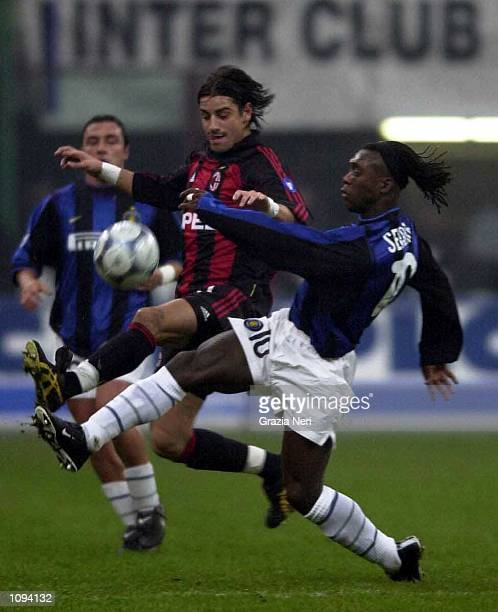 Francesco Coco of Milan battles with Clarence Seedorf of Inter during the AC Milan v Inter Milan Serie A match played at the Guiseppe Meazza in Milan...
