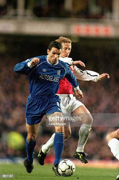 Gustavo Poyet of Chelsea takes the ball past Ray Parlour of Arsenal during the FA Carling Premiership match played at Highbury in London The match...