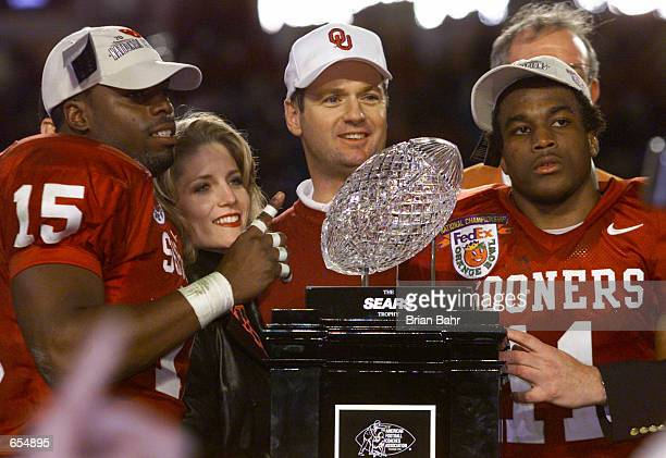 Head Coach Bob Stoops, J.T. Thatcher and Ontei Jones of the Oklahoma Sooners celebrate after defeating the Florida State Seminoles 13-2 to win the...