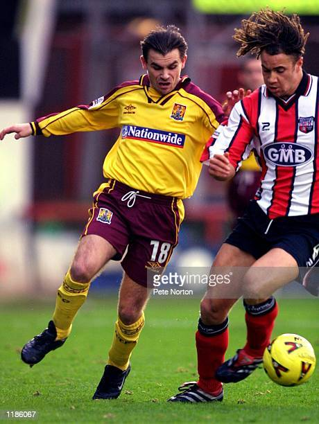 Jamie Forrester of Northampton Town chases after Gavin Mahon of Brentford during the Nationwide League Division Two match played at Griffin Park in...