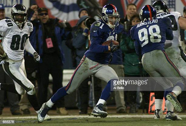 Jason Sehorn of the New York Giants returns a interception for a touchdown during the second period of the NFC Divisional playoff game against the...