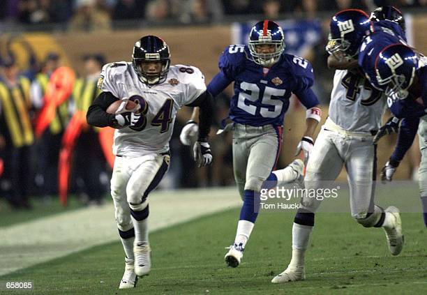 Jermaine Lewis of the Baltimore Ravens races down the sidelines for a 84 yard touchdown against the New York Giants during Super Bowl XXXV at Raymond...