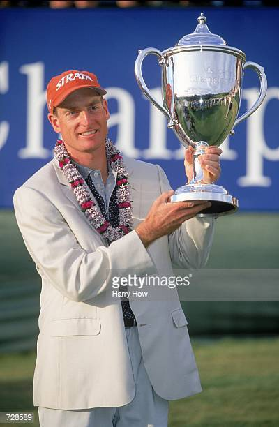 Jim Furyk poses with his winning trophy after the Mercedes Championship at the Plantation Course in Kapalua, Maui, Hawaii.Mandatory Credit: Harry How...