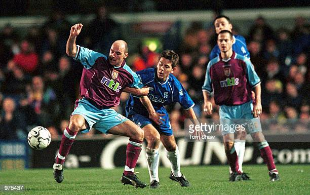 Jon Harley of Chelsea tries to tackle Steve Stone of Aston Villa during The FA Carling Premiership game between Chelsea and Aston Villa at Stamford...