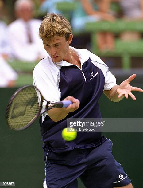 Juan Carlos Ferrero from Spain plays a forehand in his match against Yevgeny Kafelnikov from Russia during the Colonial Classic played at Kooyong...