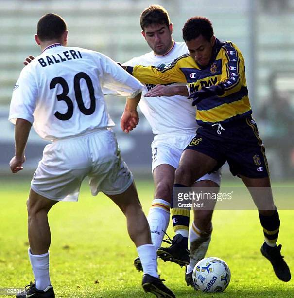 Junior of Parma tackled by Cristiano Lucarelli during a Serie A 15th Round League match between Parma and Lecce played at the Ennio Tardini Stadium...