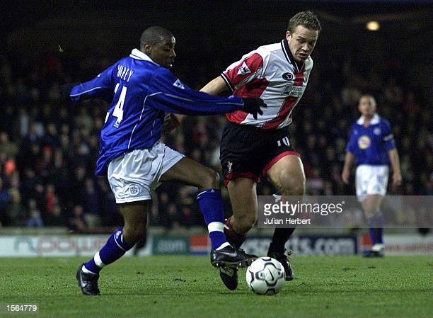 Kevin Davies of Southampton tangles with Andrew Impey of Leicester City during the FA Carling Premiership match between Southampton v Leicester City...