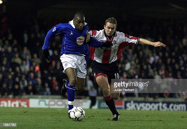 Kevin Davies of Southampton tangles with Andrew Impey of Leicester City during the FA Carling Premiership match between Southampton and Leicester...