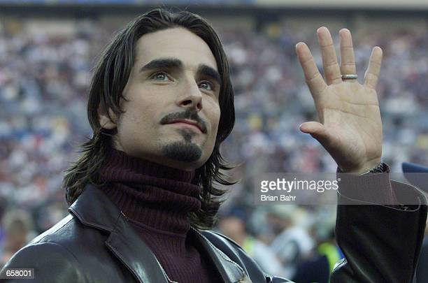 Kevin Richardson of pop group The Backstreet Boys acknowledges the crowd as he waits to sing the National Anthem before the Baltimore Ravens play the...