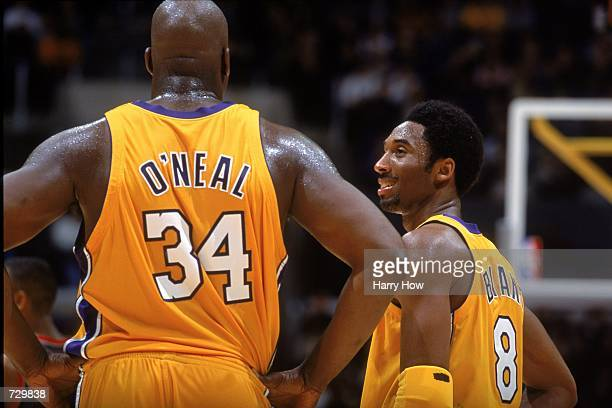 Kobe Bryant of the Los Angeles Lakers shares a moment with teammate Shaquille O''Neal during the game against the New Jersey Nets at the STAPLES...