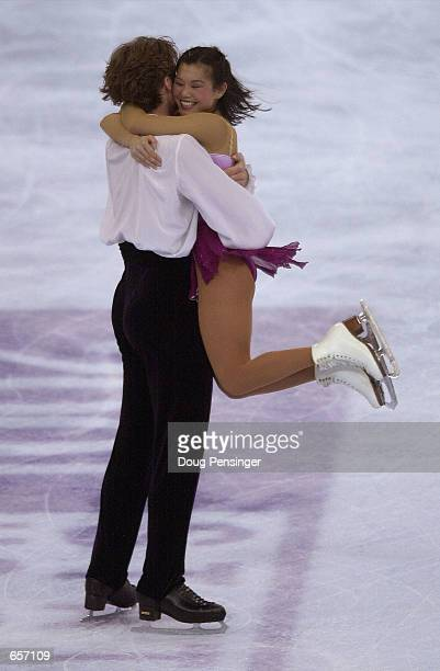 Kyoko Ina jumps into her partner's John Zimmerman arms after they competed in the Pairs Free Skate and captured first place in the Pairs Competition...