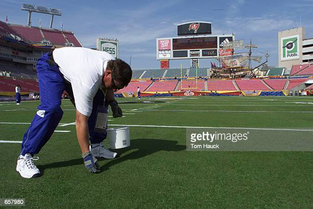 Lee Keller groundskeeper for Raymond James Stadium in Tampa Florida prepares the stadium for Super Bowl XXXV between the Baltimore Ravens and New...