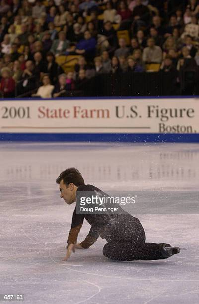 Michael Weiss makes one of several falls as he competes in the men's Free Skate and finishes in fourth place in the Men's Competition at the 2001...
