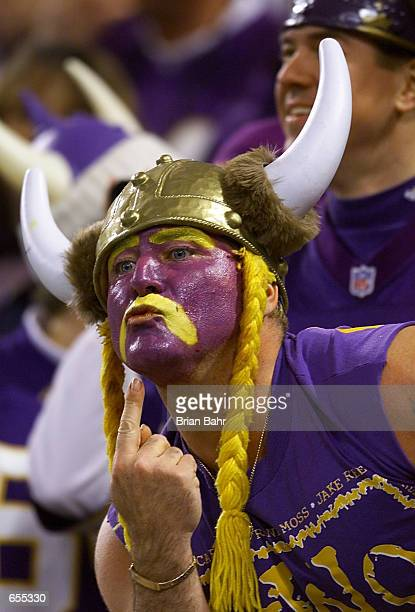 Minnesota Vikings fan Syd Davy tries to communicate with one of the New Orleans Saints before their playoff game at the Metrodome in Minneapolis,...