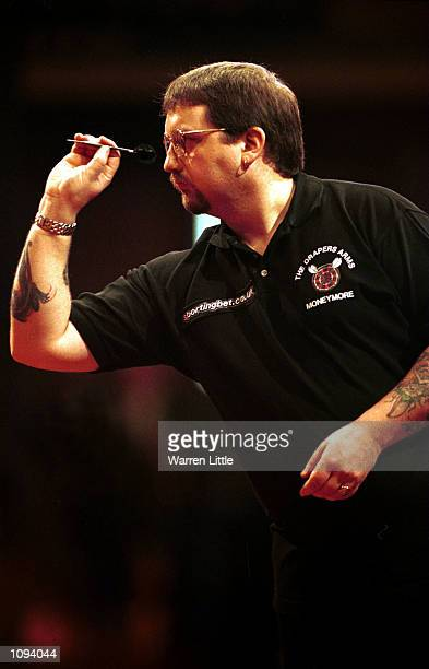 Mitchell Crooks of Northern Ireland in action during the Embassy World Darts Championship against Ronnie Baxter of England held at the Lakeside...