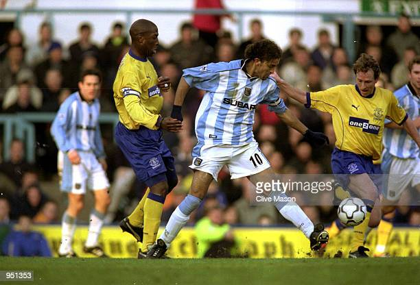 Mustapha Hadji of Coventry City tussles with Kevin Campbell and Scott Gemmill of Everton during the FA Carling Premiership match played at Highfield...