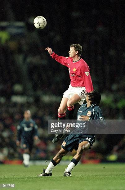 Ole Gunnar Solskjaer of Manchester United rises above Rigobert Song of West Ham during the FA Carling Premiership match played at Old Trafford in...