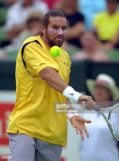 Pat Rafter from Australia plays a backhand in his match against Nicolas Lapentti from Ecuador during the Colonial Classic played at Kooyong Lawn...