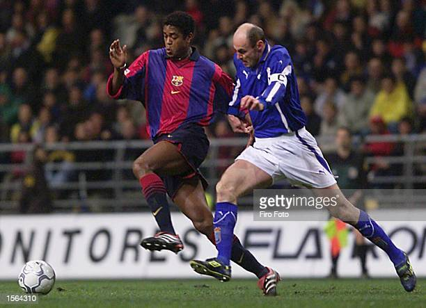 Patrick Kluivert of Barcelona and Viktor Onopko of Oviedo challenge for the ball during the Primera Liga match between Oviedo and Barcelona played at...