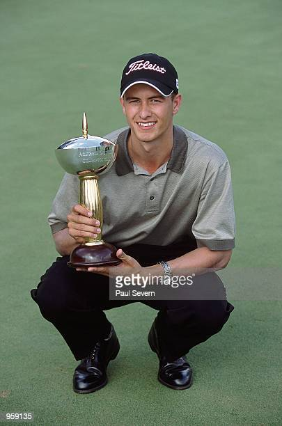 Portrait of Adam Scott of Australia holding the trophy after winning the Alfred Dunhill Championship at Houghton GC in Johannesburg South Africa...