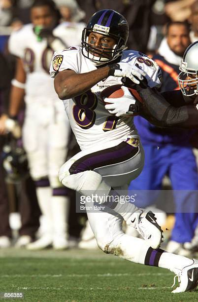 Qadry Ismail of the Baltimore Ravens runs upfield against the Oakland Raiders during the AFC Championship game at Network Associates Coliseum in...