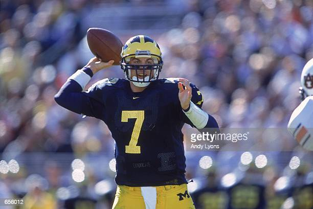 Quarterback Drew Henson of the Michigan Wolverines gets ready to pass the ball during the Citrus Bowl Game against the Auburn Tigers at the Citrus...