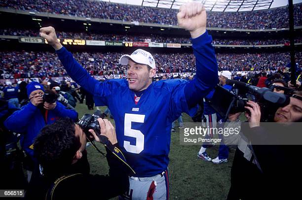 Quarterback Kerry Collins of the New York Giants celebrates winning the NFC Championship game 41-0 over the Minnesota Vikings at Giants Stadium, East...