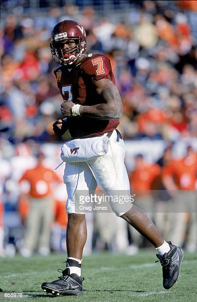 Quaterback Michael Vick the Virginia Tech Hokies jogs on the field during the Gator Bowl Game against the Clemson Tigers at the Gator Bowl in...